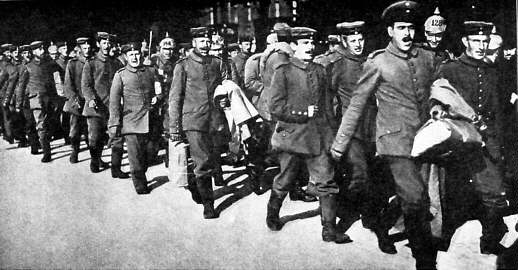 Germans sing while marching to war