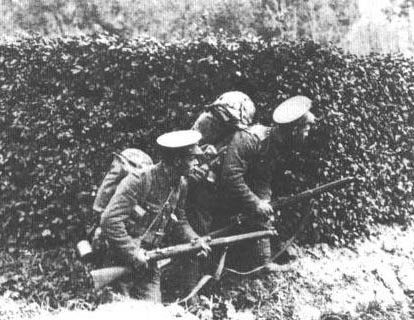 Riflemen of the BEF Sneak Around a Hedgerow near Mons